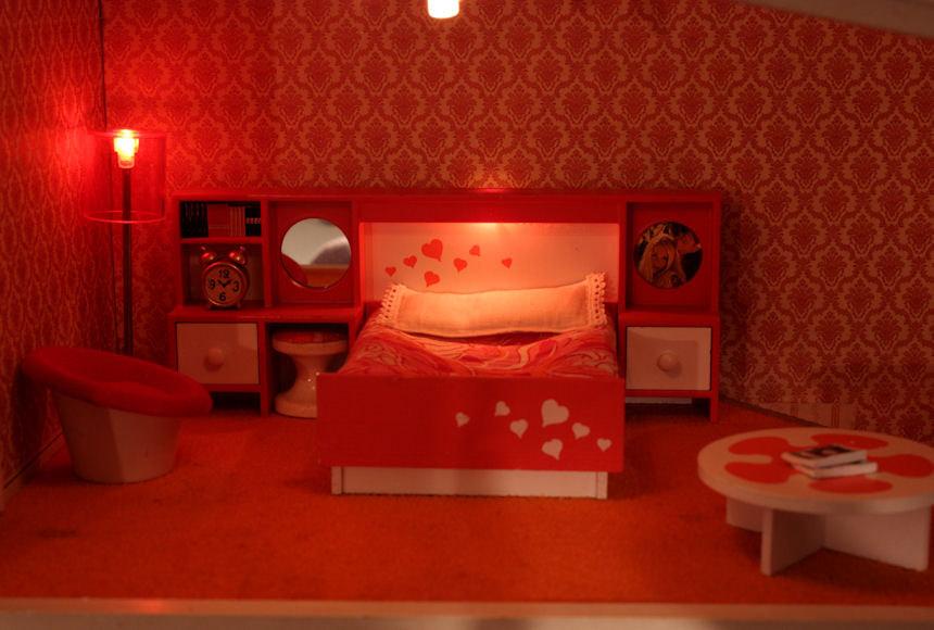 The bedroom with the lights on. I just bought the alarm clock by the bed. It is vintage Lundby